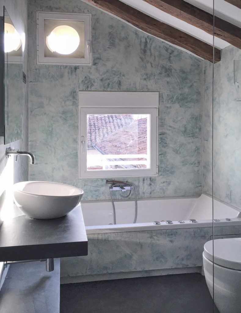 renovate your bathroom with microcement is easy to clean and maintain.